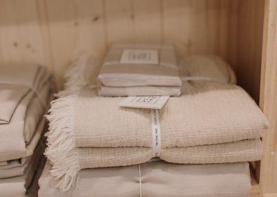 folded blankets on a shelf