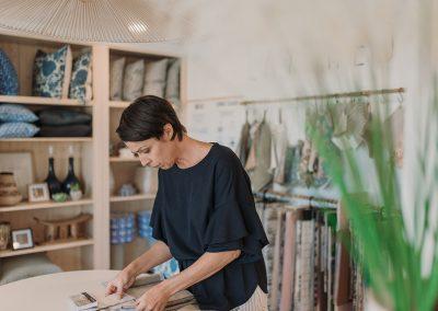 woman looking at fabric