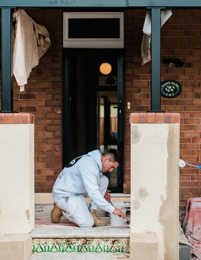 two men painting a house