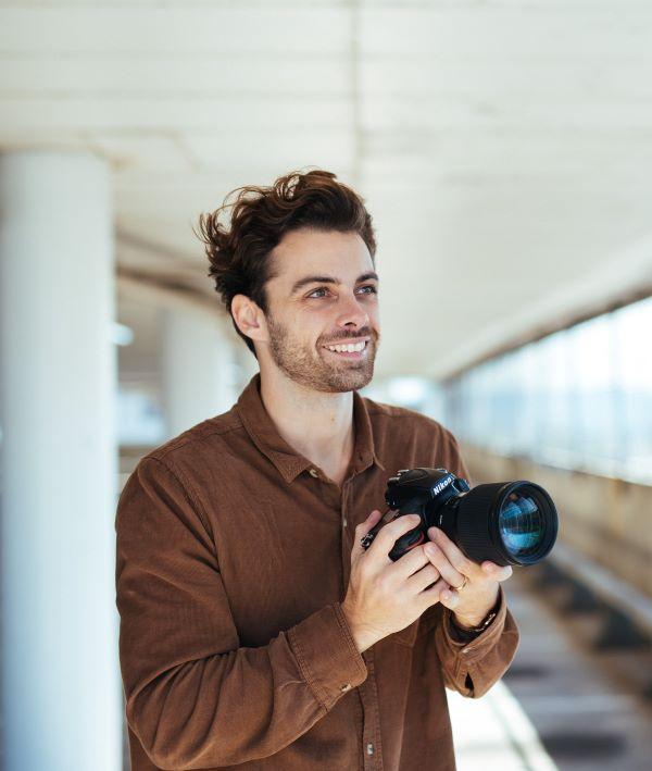 Jacob holding a camera